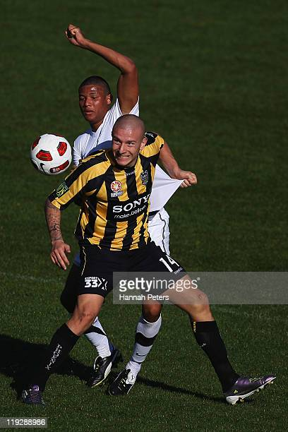 Mirjan Pavlovic of the Phoenix competes with James Musa of the Junior All Whites during the preseason friendly match between the Wellington Phoenix...