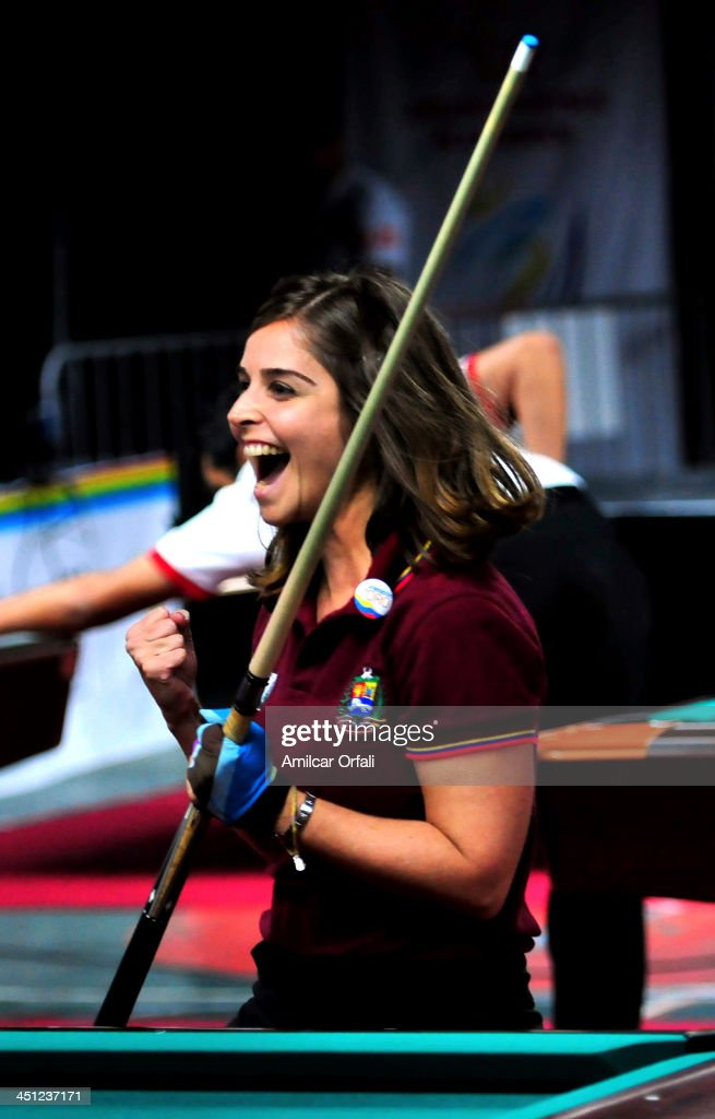 Mirjana Grujicic (R) and Carlyn Sanchez (out of frame) celebrates the gold medal during the billiards finals pool nine ball ladies team as part of the XVII Bolivarian Games Trujillo 2013 at Morro del Solar on November 21, 2013 in Lima, Peru.