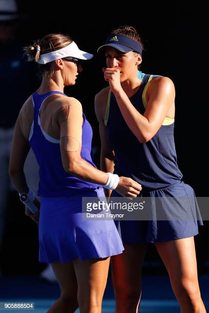 Mirjana LucicBaroni of Croatia and Andrea Petkovic of Germany talk tactics in their first round doubles match against Monica Niculescu of Romania and...