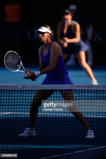 Mirjana LucicBaroni of Croatia waits at the net in her first round doubles match with Andrea Petkovic of Germany against Monica Niculescu of Romania...