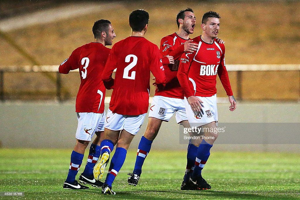 Mirjian Pavlovic of United celebrates with team mates after scoring the opening goal during the FFA Cup match between Sydney United 58 FC and the FNQ Heat at Sydney United Sports Centre on August 12, 2014 in Sydney, Australia.
