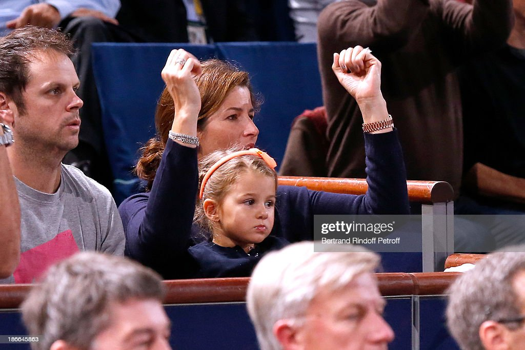 Mirka Federer and her daughter watch her husband Roger Federer plays during day six of the BNP Paribas Tennis Masters, held at Bercy on November 2, 2013 in Paris, France.