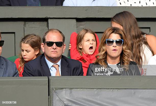 Mirka Federer and twin daughters Myla Rose Federer and Charlene Riva Federer attend day one of the Wimbledon Tennis Championships at Wimbledon on...