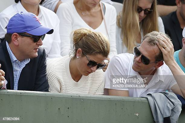 Mirka Federer the wife of Switzerland's Roger Federer and his coach Stefan Edberg attend his men's quarter final match against Switzerland's...