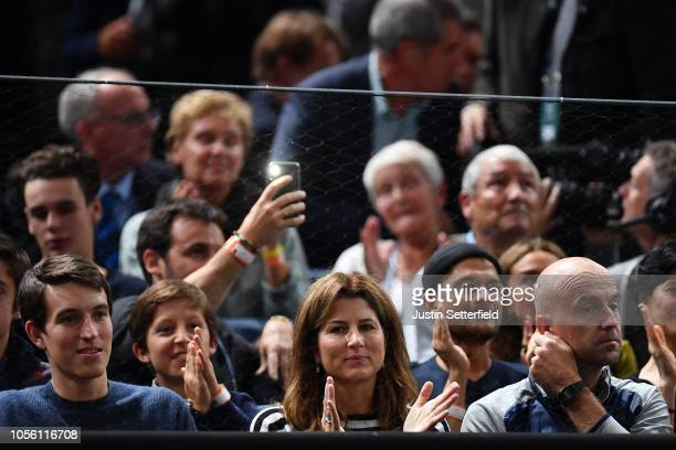 Mirka Federer watches Roger Federer of Switzerland during Day 4 of the Rolex Paris Masters on November 1 2018 in Paris France