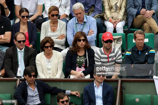 Mirka Federer wife of Roger Federer of Switzerland and Stefan Edberg watch his men's singles match against Dmitry Tursunov of Russia on day six of...