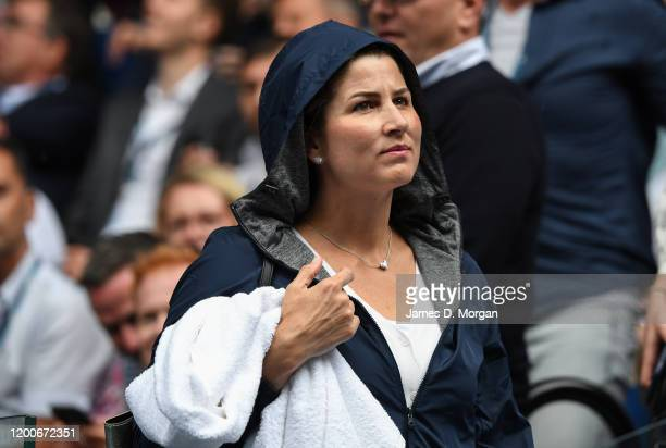 Mirka Federer wife of Roger Federer puts on her rain jacket on Rod Laver Arena during a rain delay on day one of the 2020 Australian Open at...