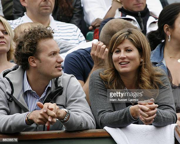 Mirka Vavrinec attends the second round match between Switzerland's Roger Federer and Argentina's Jose Acasuso at the French Open tennis tournament...