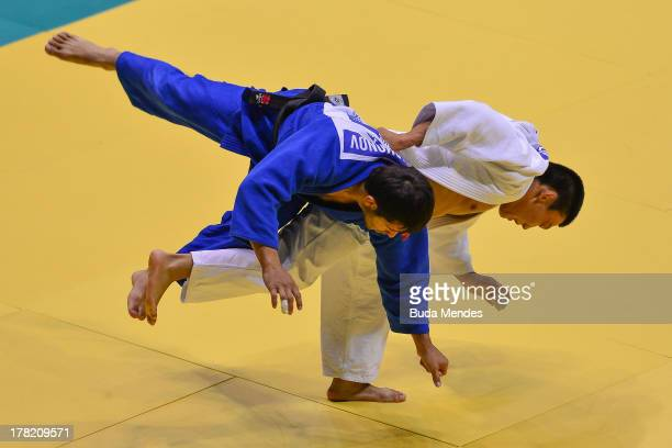Mirkahid Farmonov of Uzbekistan fights against Sergey Lim of Kazakhstan in the 66 kg category during the World Judo Championships at Gymnasium...