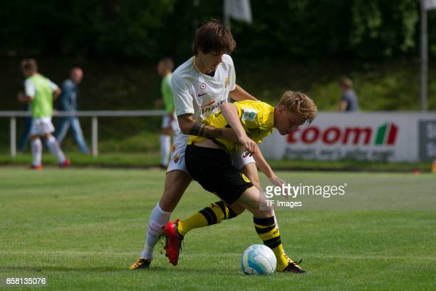 Mirko Antonucci of Rom and Alexander Schulte of Dortmund battle for the ball during the EMKA RUHRCup International match between Borussia Dortmund...