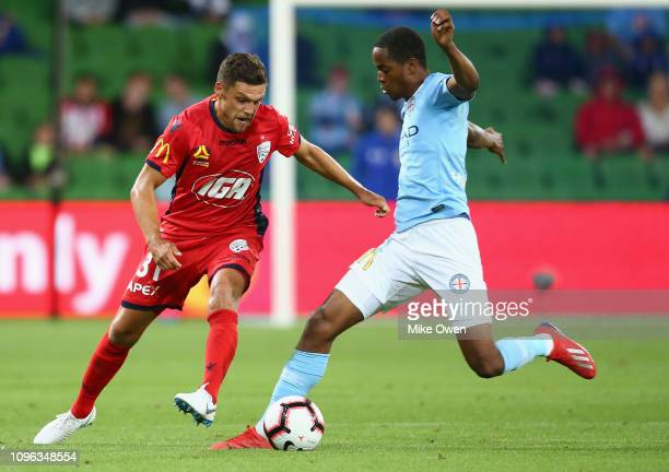 Mirko Boland of Adelaide United and Shayon Harrison of Melbourne City compete for the ball during the round 18 ALeague match between Melbourne City...