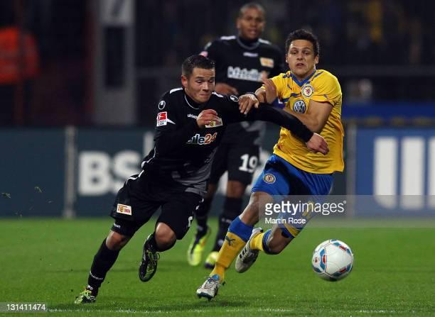 Mirko Boland of Braunschweig and Christopher Quiring of Berlin battle for the ball during the Second Bundesliga match between Eintracht Braunschweig...