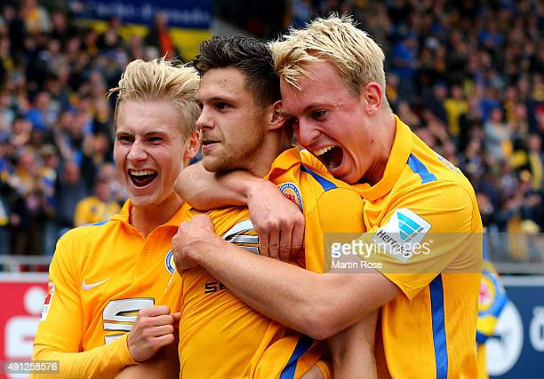 Mirko Boland of Braunschweig celebrate with his team mates after scoring the 2nd goal during the Second Bundesliga match between Eintracht...