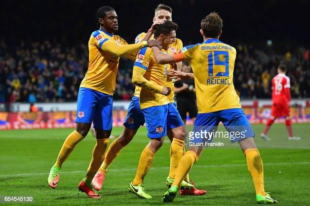 Mirko Boland of Braunschweig celebrates his team's first goal with team mates during the Second Bundesliga match between Eintracht Braunschweig and 1...