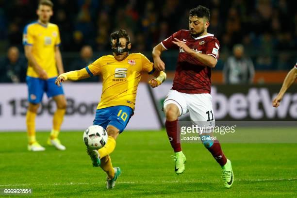 Mirko Boland of Braunschweig challenges Aias Aosman of Dresden during the Second Bundesliga match between Eintracht Braunschweig and SG Dynamo...