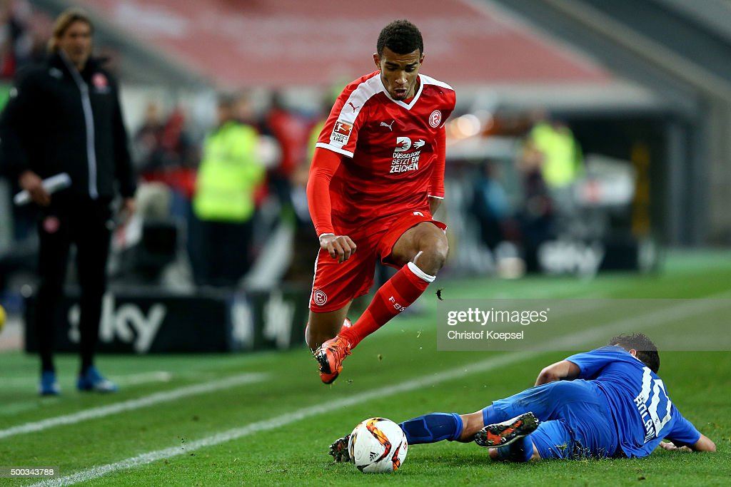 Mirko Boland of Braunschweig (R) challenges Kevin Akpoguma of Duesseldorf (L) during the Second Bundesliga match between Fortuna Duesseldorf and Eintracht Braunschweig at Esprit-Arena on December 7, 2015 in Duesseldorf, Germany.
