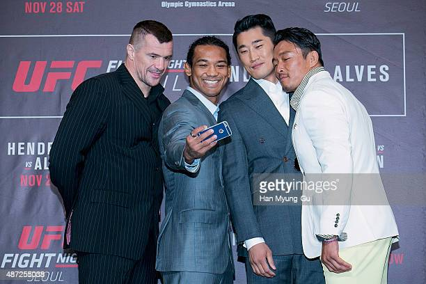 Mirko Cro Cop Benson Henderson Dong Hyun Kim and Sung Hoon Choo pose for photographs during the UFC Fight Night Seoul OnSale Press Conference at The...