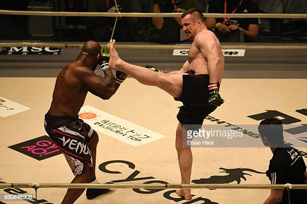 Mirko Cro Cop of Croatia kicks King Mo of the United States in the bout during the RIZIN Fighting World GP 2016 second round at Saitama Super Arena...