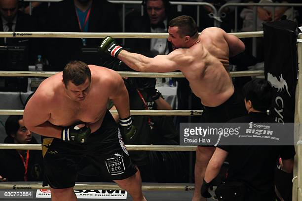 Mirko Cro Cop of Croatia punches Baruto of Estonia in the SemiFinal bout during the RIZIN Fighting World GP 2016 final round at Saitama Super Arena...