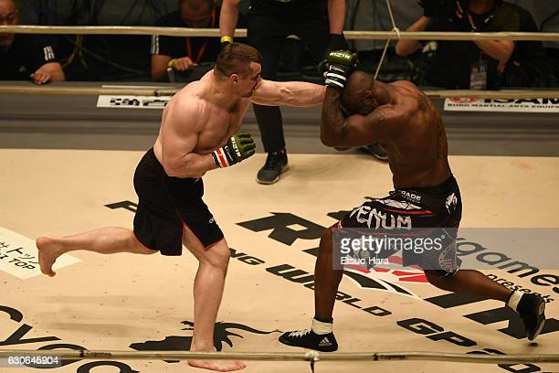 Mirko Cro Cop of Croatia punches King Mo of the United States in the bout during the RIZIN Fighting World GP 2016 second round at Saitama Super Arena...