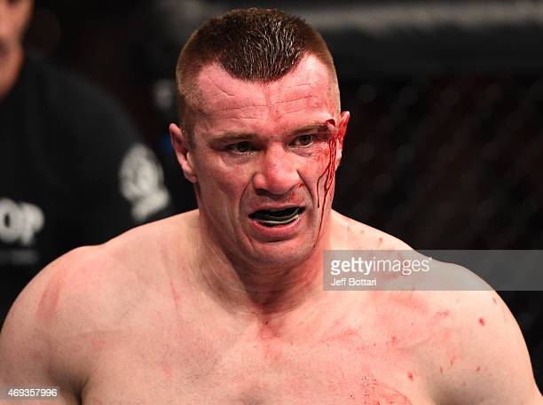 Mirko Cro Cop of Croatia walks back to his corner after the second round of his heavyweight fight against Gabriel Gonzaga of Brazil during the UFC...
