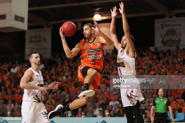 Mirko Djeric of the Taipans passes the ball during the round one NBL match between the Cairns Taipans and the Illawarra Hawks at Cairns Pop Up Arena,...