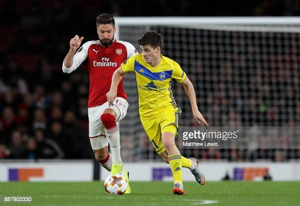 Mirko Ivanic of BATE Borisov holds off pressure from Olivier Giroud of Arsenal during the UEFA Europa League group H match between Arsenal FC and...