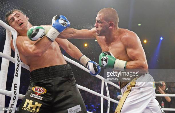 Mirko Larghetti of Italy and Marco Huck of Germany exchange punches during their WBO Cruiserweight World Championship fight at the Gerry Weber...