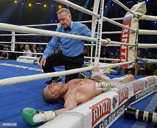 Mirko Larghetti of Italy lies on the ground during his WBO Cruiserweight World Championship fight against Marco Huck of Germany at the Gerry Weber...