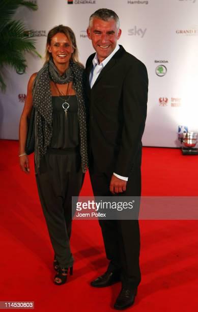 Mirko Slomka and his wife arrive for the Herbert Award 2011 Gala at the Elysee Hotel on May 23 2011 in Hamburg Germany