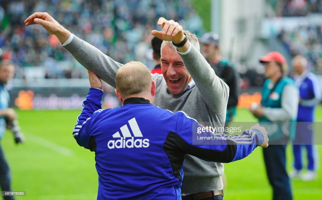 Mirko Slomka (R), head coach of Hamburg celebrates after the Bundesliga Playoff Second Leg match between SpVgg Greuther Fuerth and Hamburger SV at Trolli-Arena on May 18, 2014 in Fuerth, Germany.