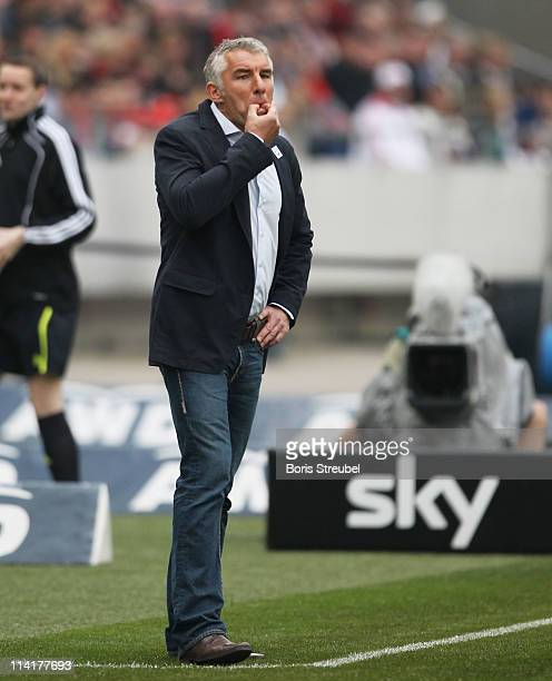 Mirko Slomka head coach of Hannover gestures during the Bundesliga match between Hannover 96 and 1 FC Nuernberg at AWD Arena on May 14 2011 in...