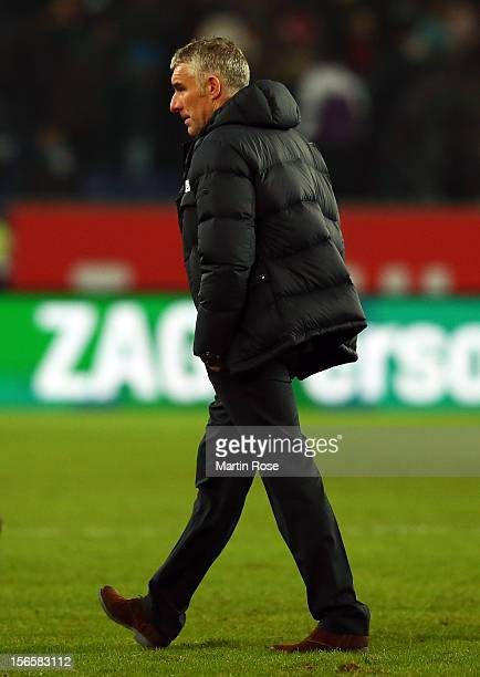 Mirko Slomka, head coach of Hannover looks dejected after the Bundesliga match between Hannover 96 and SC Freiburg at AWD Arena on November 17, 2012...