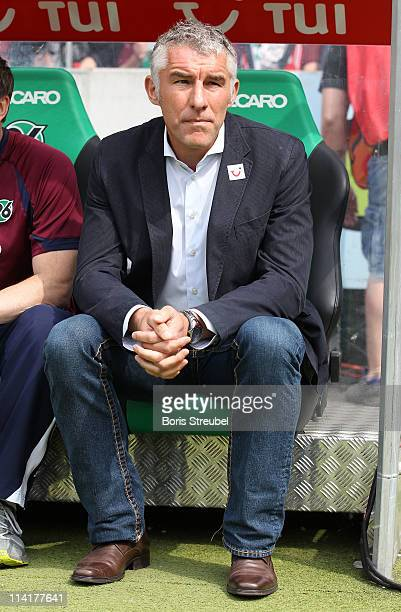 Mirko Slomka head coach of Hannover sits on the bench prior to the Bundesliga match between Hannover 96 and 1 FC Nuernberg at AWD Arena on May 14...