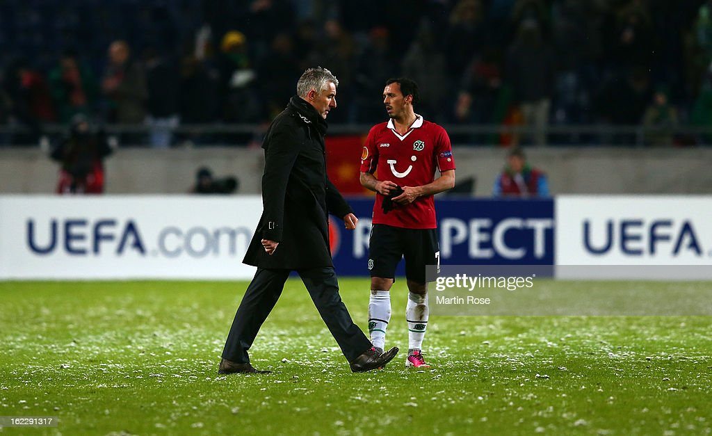 Mirko Slomka, head coach of Hannover walks off dejected after the UEFA Europa League Round of 32 second leg match between Hannover 96 and Anji Makhachkala at AWD Arena on February 21, 2013 in Hannover, Germany.