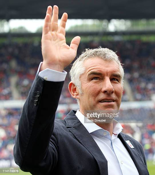 Mirko Slomka head coach of Hannover waves to the fans during the Bundesliga match between Hannover 96 and 1 FC Nuernberg at AWD Arena on May 14 2011...