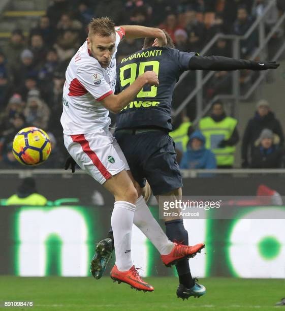 Mirko Stefani of Pordenone Calcio jumps for the ball against Andrea Pinamonti of FC Internazionale Milano during the TIM Cup match between FC...