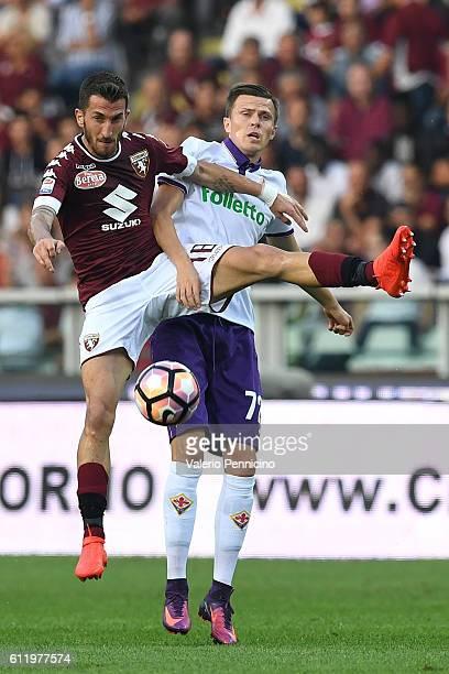 Mirko Valdifiori of FC Torino clashes with Josip Ilicic of ACF Fiorentina during the Serie A match between FC Torino and ACF Fiorentina at Stadio...