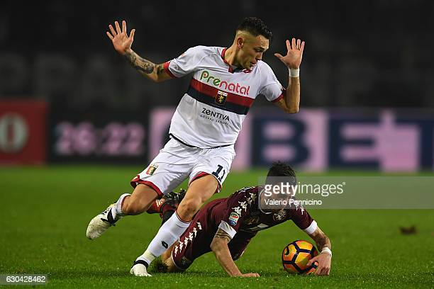 Mirko Valdifiori of FC Torino is tackled by Lucas Ocampos of Genoa CFC during the Serie A match between FC Torino and Genoa CFC at Stadio Olimpico di...