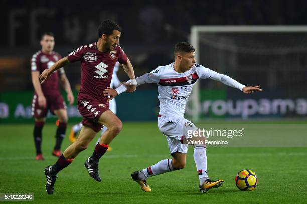 Mirko Valdifiori of Torino FC competes with Nicolo Barella of Cagliari Calcio during the Serie A match between Torino FC and Cagliari Calcio at...