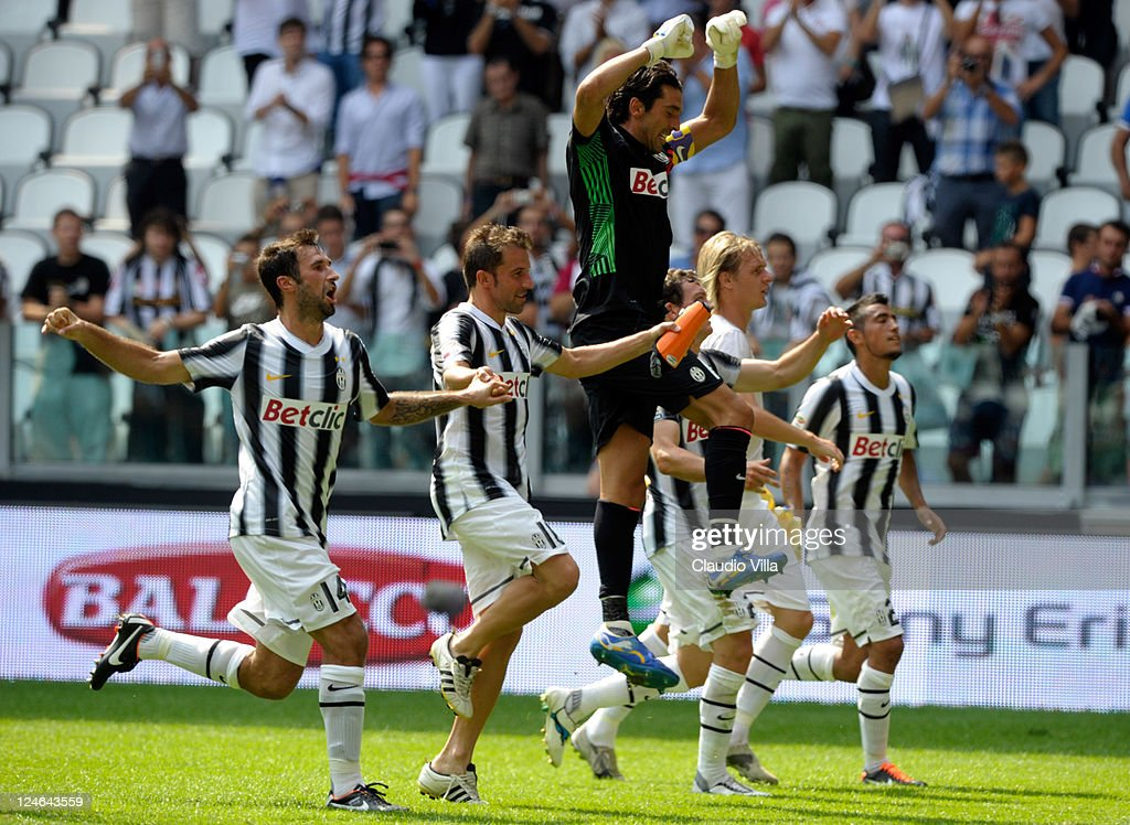 Mirko Vucinic, Alessandro Del Piero and Gianluigi Buffon of Juventus FC celebrate their victory after the Serie A match between Juventus FC v Parma FC at Juventus Stadium on September 11, 2011 in Turin, Italy.