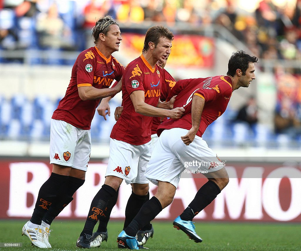 Mirko Vucinic (R) and players of AS Roma celebrate the opening goal during the Serie A match between AS Roma and Bologna FC at Stadio Olimpico on November 1, 2009 in Rome, Italy.
