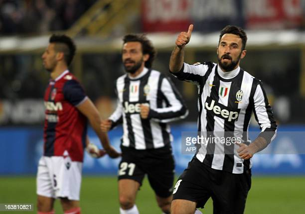 Mirko Vucinic celebrates after scoring with Andrea Pirlo during the Italian Serie A match between Bologna and Juventus on March 16 2013 in Bologna...