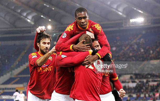 Mirko Vucinic Juan and Daniele De Rossi of AS Roma celebrate with team mate Matteo Brighi after he scored the opening goal during the Serie A match...