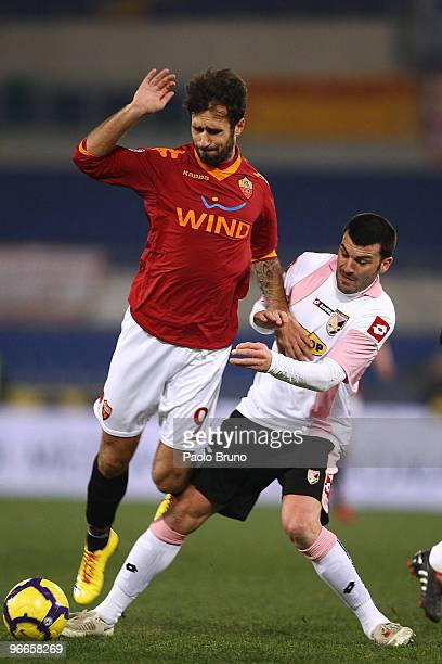 Mirko Vucinic of AS Roma and Cesare Bovo of US Citta' di Palermo in action during the Serie A match between AS Roma and US Citta di Palermo at Stadio...
