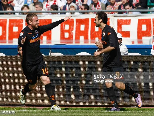 Mirko Vucinic of AS Roma celebrates his goal with Daniele De Rossi during the Serie A match between AS Bari and AS Roma at Stadio San Nicola on April...