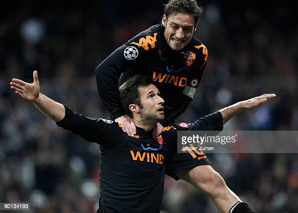 Mirko Vucinic of AS Roma celebrates his goal with his teammate Francesco Totti during the UEFA Champions League first knockout round second leg match...