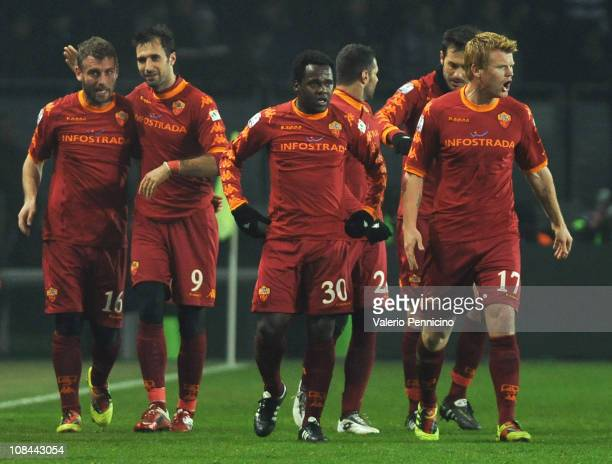 Mirko Vucinic of AS Roma celebrates with Daniele De Rossi and team mates after scoring the opening goal during the TIM Cup match between Juventus FC...