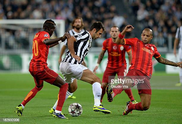 Mirko Vucinic of Juventus and Felipe Melo of Galatasaray AS compete for the ball during UEFA Champions League Group B match between Juventus and...