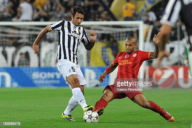 Mirko Vucinic of Juventus competes with Felipe Melo of Galatasaray AS during UEFA Champions League Group B match between Juventus and Galatasaray AS...